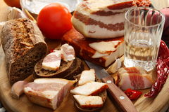 Glass of vodka bacon on rye bread. Stock Image
