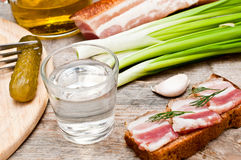 Glass of vodka and bacon sandwich Stock Photos