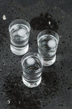 A glass of vodka on the black table Royalty Free Stock Photography