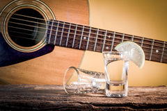 Glass of vodka and Classical guitar Royalty Free Stock Images