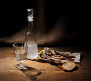 Glass of vodka with dried capelin and bread Royalty Free Stock Image
