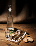 Glass of vodka with dried capelin and bread Stock Image