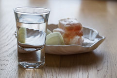 Glass with vodka, lard and onions Royalty Free Stock Images
