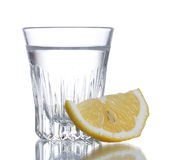 Glass of vodka   with lemon. Glass of vodka with lemon isolated on white Royalty Free Stock Images