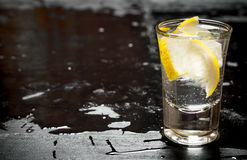 Glass with vodka and lemon. Royalty Free Stock Photos