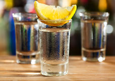 Glass of vodka with lemon Royalty Free Stock Photos