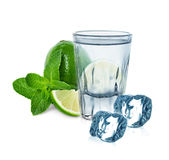 Glass of vodka with lime, mint and ice cubes Stock Photography