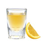 Glass of vodka with pepper and lemon slice Royalty Free Stock Images