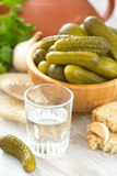 Glass of vodka with pickled cucumbers and garlic Stock Photos