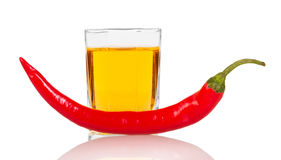 Glass  vodka with red chili pepper isolated on white background. Stock Photos
