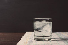 Glass of vodka on the rocks Royalty Free Stock Photos
