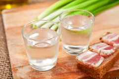 Glass of vodka and sandwich Royalty Free Stock Photography