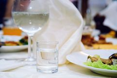 A glass with vodka on a serving table. Close-up. royalty free stock images