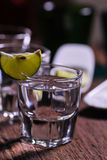 Glass of vodka shot with fresh lime Stock Photo