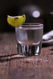 Glass of vodka shot with fresh lime Royalty Free Stock Photos