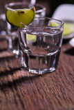 Glass of vodka shot with fresh lime Royalty Free Stock Images