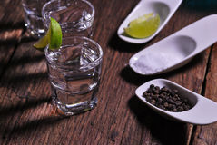 Glass of vodka shot with fresh lime Royalty Free Stock Image