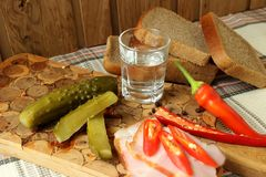 A glass of vodka and a snack Royalty Free Stock Photo