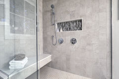 Glass walk-in shower in a bathroom of brand new home Stock Photography