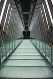 Glass Walkway. A glass walkway to an exit door royalty free stock photo