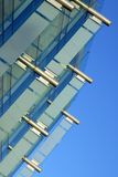 Glass Wall. Detail of a glass curtain wall against a blue sky royalty free stock photos