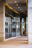 Glass wall. Arcade with a glass wall - part of modern building Stock Photography