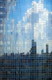 Glass wall of beautiful buildi. Glass wall of modern beautiful building in Kiev. Fragmented reflection Stock Photography