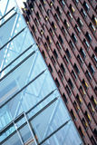Glass wall and brick building Stock Images