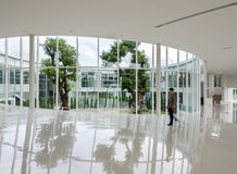 Glass wall in the building with people walking Royalty Free Stock Photo
