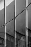 Glass wall building with reflection Stock Images