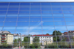 Glass wall of building with reflection of blue sky Stock Photography