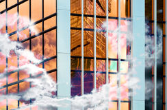 Glass wall of business center, reflection of buildings, business background Stock Photos