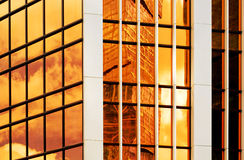 Glass wall of business center, reflection of buildings, business background Royalty Free Stock Photos