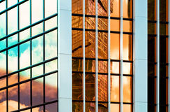 Glass wall of business center, reflection of buildings, business background Royalty Free Stock Photography
