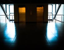 Glass wall with door to elevators in office building Royalty Free Stock Photography