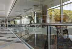 A glass wall in the hallway of the building Stock Image
