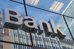 The glass wall with the inscription Bank Stock Images