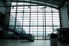 Glass wall in international airport Royalty Free Stock Photos