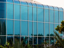 Glass wall of modern building with rounded corners royalty free stock photography