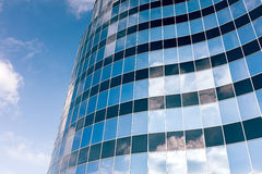 Glass wall of the office building with clouds reflection Royalty Free Stock Images