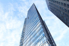 Glass wall of office building. With reflection of clouds Royalty Free Stock Photo