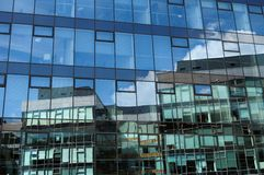 Glass wall of office building with reflections Royalty Free Stock Images
