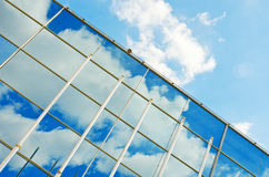 Glass wall of the office modern building structure. Business arc. Hitecture background. Window reflection Royalty Free Stock Images