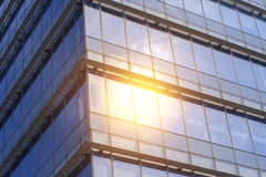 The glass wall reflect the sun and cloud Stock Photo