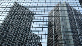 Glass wall with reflected buildings stock photo