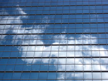 Glass wall with the reflection of sky Stock Photos
