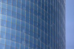 Glass wall of a skyscraper Royalty Free Stock Images