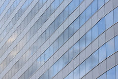Glass wall of a skyscraper. Glass wall of a skyscraper for design business background in your work Stock Image