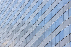Glass wall of a skyscraper. Glass wall of a skyscraper for design business background in your work Royalty Free Stock Image