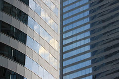 Glass wall of a skyscraper. Glass wall of a skyscraper for design business background in your work Royalty Free Stock Images